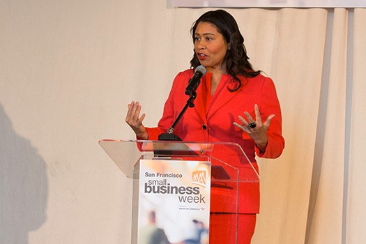 Politico, Mayor London Breed at podium during SF Small Business Week