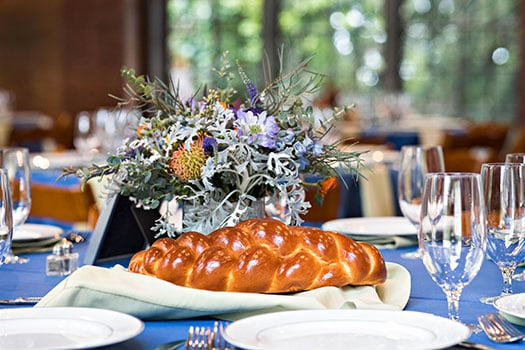 Staged Luncheon Tabletop With Bread and Florals