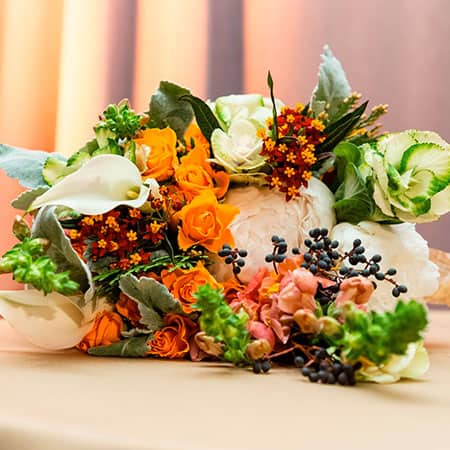Produce and floral bouquet, orange, red, purple, green, white
