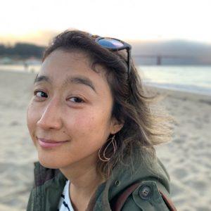 A headshot of Aki Amai
