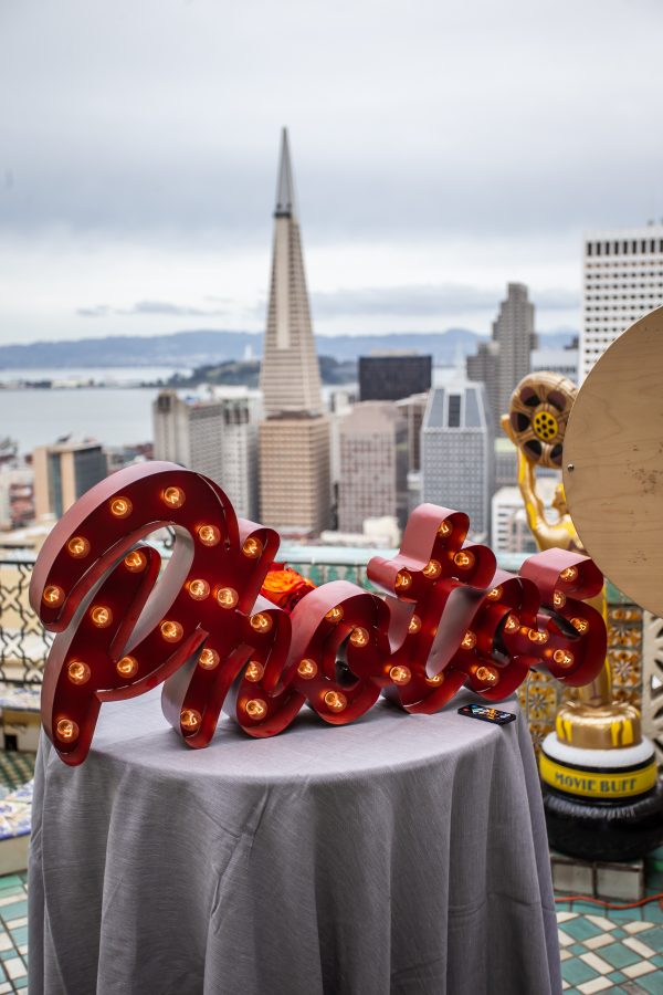 A photo booth signage at a nonprofit's Oscar-themed Gala, overlooking San Francisco's skyline.