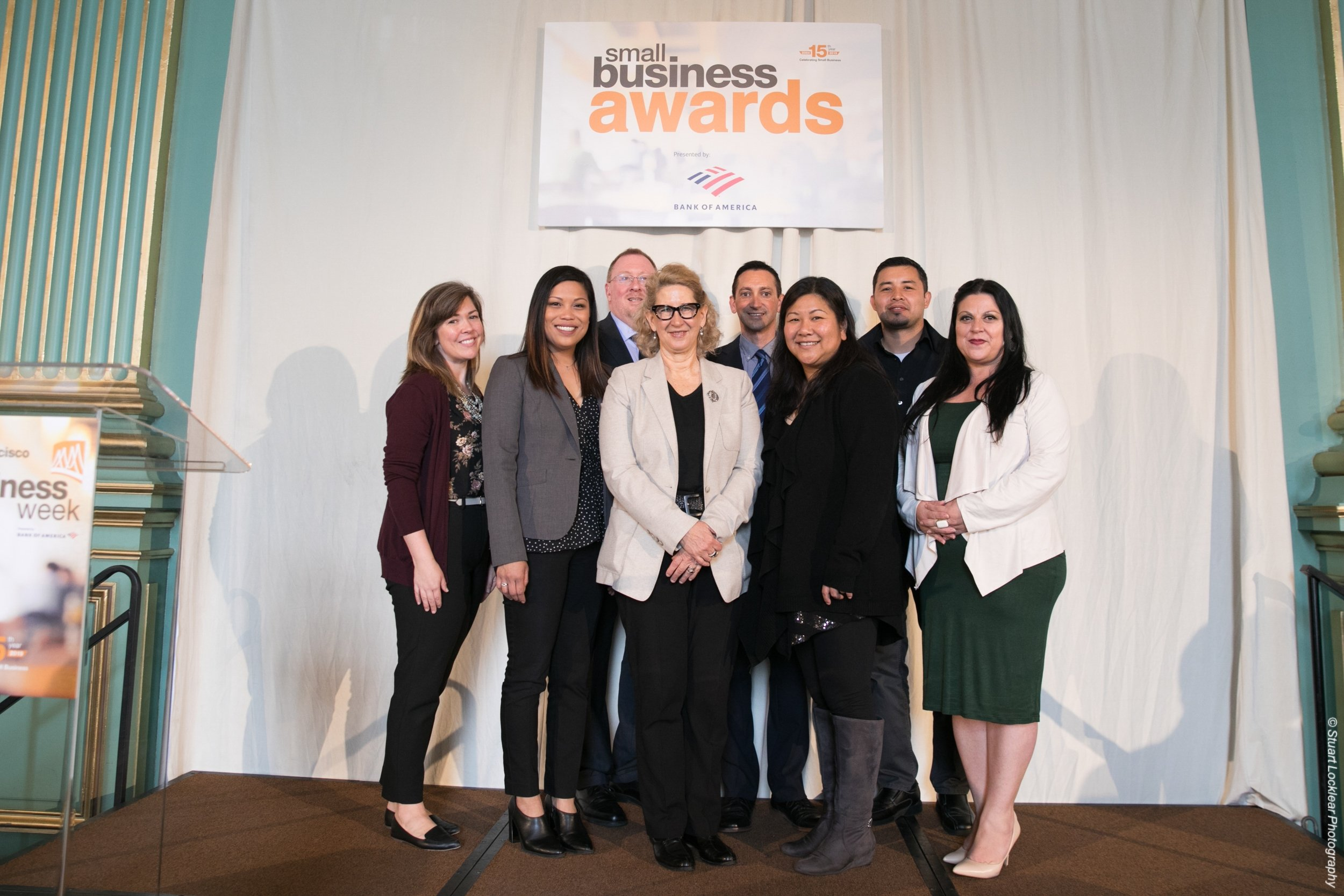 A formal group picture at San Francisco's Small Business week Conference/Summit, on the stage for the Small Business Awards.